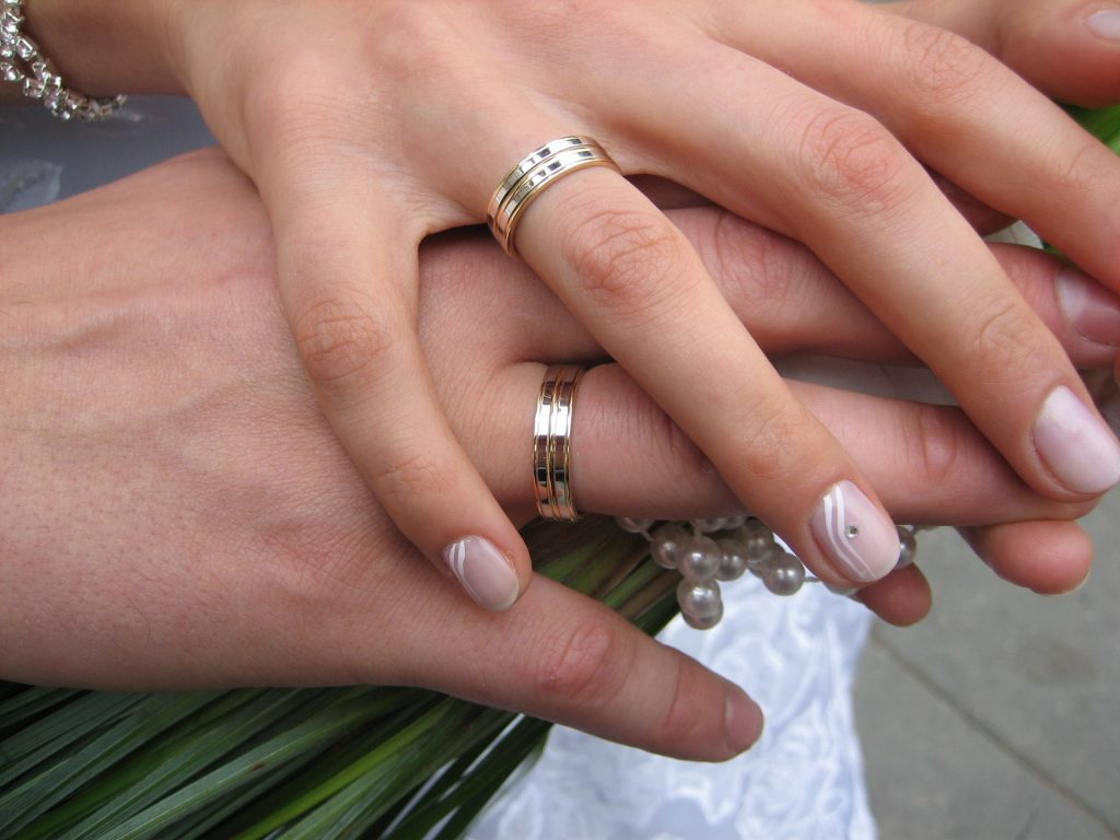 a couple getting married holding hands have a prenuptial agreement
